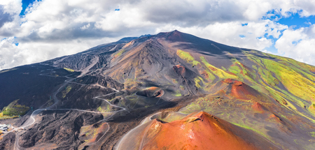 Panoramic wide view of the active volcano Etna, extinct craters on the slope, traces of volcanic activity Imagens