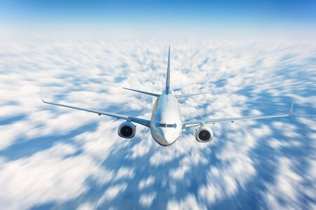 Traveling fly by airplane above the clouds, high speed motion blur effect