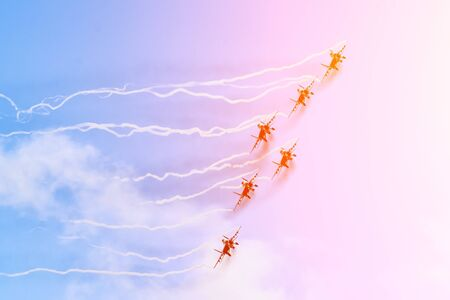 Group of fighters in the sky with a trace of black smoke and traces of white vapor vortex clouds 写真素材