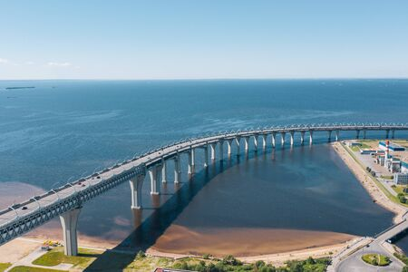 Aerial view of the Viaduct with a car high-speed highway with a turn over the sea bay