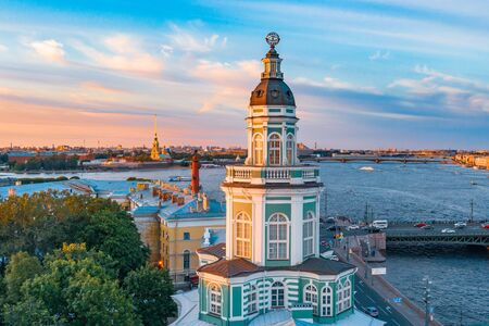 Kunstkamera at sunset on a summer evening and in the background Rostral columns on the Spit of Vasilyevsky Island and the Peter and Paul Fortress