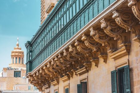 Malta's long large green traditional style balconies 免版税图像 - 126756652