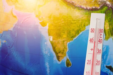 Thermometer with a high temperature of forty degrees Celsius, against the background of continent Indian subcontinent. Hot weather concept