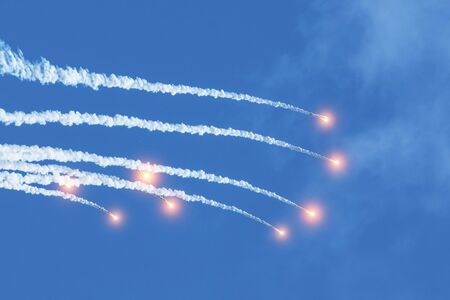 Falling burning flares of several meteorites of asteroids in the day sky