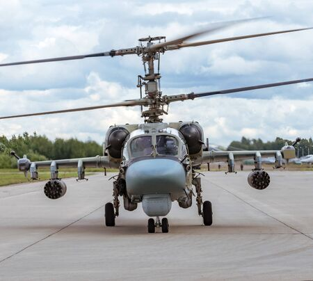Military combat helicopter taxis on the steering track