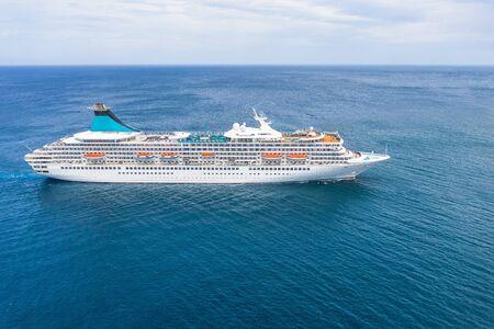 Cruise ship liner sails in the blue sea leaving a plume, seascape. Aerial view The concept of sea travel, cruises Archivio Fotografico - 128398845