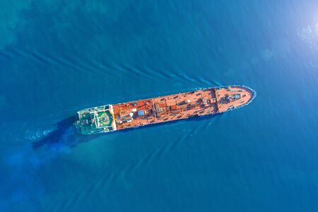 Aerial view tanker ship with liquid bulk cargo is sailing in blue water Фото со стока - 129843694