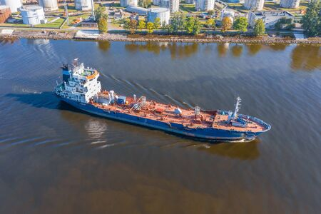 Aerial view tanker ship with liquid bulk cargo is sailing in channel water Фото со стока - 129843697