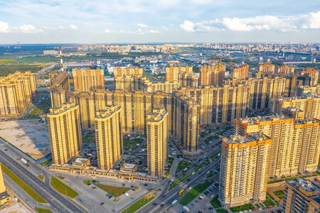 Aerial view huge residential area with multi-storey residential complexes, away from the industrial area of the city and the sky Stock fotó