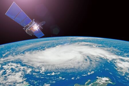Research, probing, monitoring hurricane. Satellite above the Earth makes measurements of the weather parameters. Elements of this image furnished by NASA 写真素材