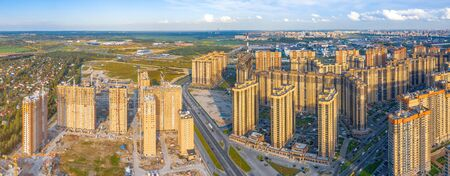 Aerial view panoramic huge residential area with multi-storey residential complexes, away from the industrial area of the city and the sky