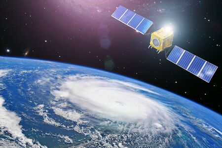 Monitoring hurricane. Satellite above the Earth makes measurements of the weather parameters and movement trajectory.