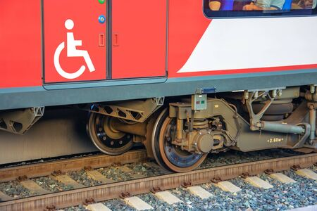 Passenger city carriage train with a door and a sign - a car for transporting people with disabilities Stock Photo