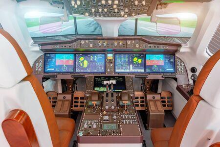 Inside of flight simulator cockpit - dashboard, autopilot, engine management. Runway view Foto de archivo