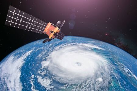 Monitoring hurricane. Satellite above the Earth makes measurements of the weather parameters and movement trajectory forecast.