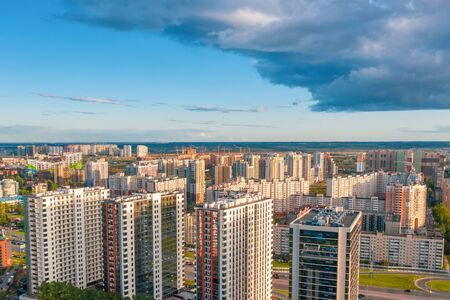 Huge residential area multi-storey high-rise buildings to the horizon, the evening sky view sunset light
