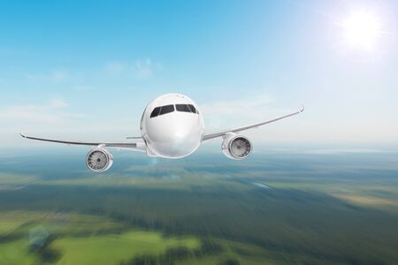 Big jet airplane flying on blur motion sky background below ground, gaining height 写真素材