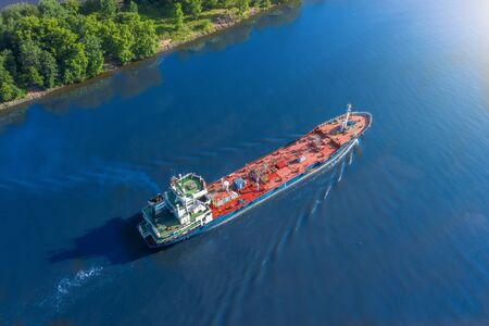 Aerial view tanker ship with liquid bulk cargo is sailing in channel water