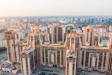 Huge residential area multi-storey high-rise buildings to the horizon, the evening sky aerial view