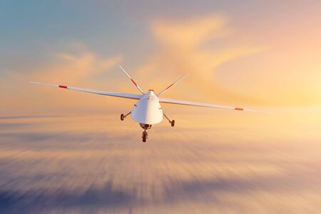 Unmanned military drone patrols high in the sky at sunset. The view is straight ahead