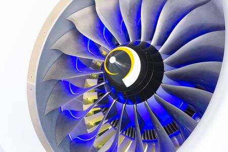 Turbo jet engine of the plane, close up in the blue light from the inside