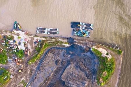 Bulk territories on the shore of the sea bay, dumping of soil artificial island aerial top view Stock fotó