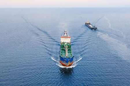 Cargo tanker with oil products floats on water in the Gulf of the North Seas, aerial view