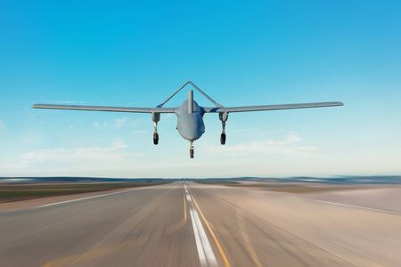 Unmanned military drone landing on runway military base Stock Photo