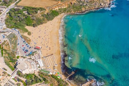 Aerial vew from fying drone view of the wild beach with sunbathers resting people