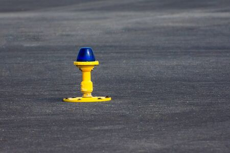 Ground side lamp taxiway at the airport close up view Banco de Imagens
