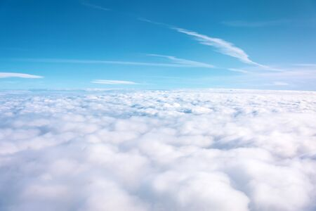 Aerial view of cloudy fields and horizon with day blue sky Banco de Imagens