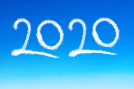 The inscription numbers 2020 trace from the plane in the blue sky, New Years Eve Reklamní fotografie