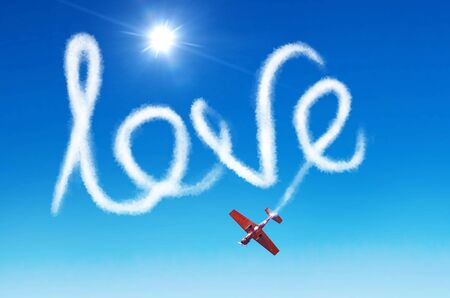 Inscription in the sky - love left by white smoke from an airplane