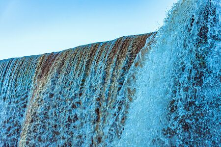 Close-up of a waterfall showing the smooth tumbling water