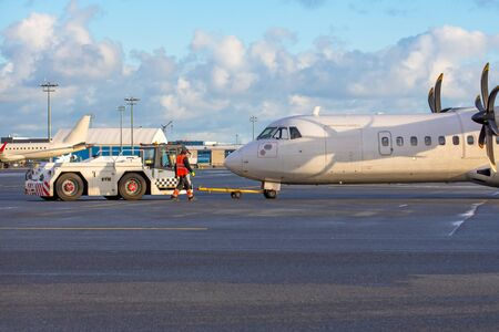 Turboprop aircraft towing airport, engine start preparation