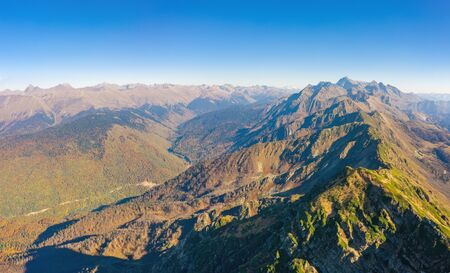 Birds-eye view of a mountain range and slopes with a mountain valley 스톡 콘텐츠