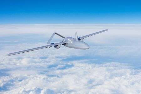 Unmanned aerial vehicles spy in the sky flying over dense clouds over the territory of patrol