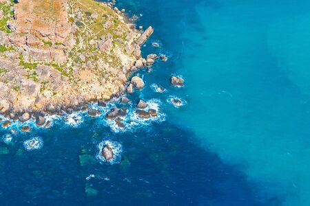 Rocky coast of the island by the sea, aerial view