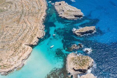 Aerial view drone - blue lagoon among the rocks sea