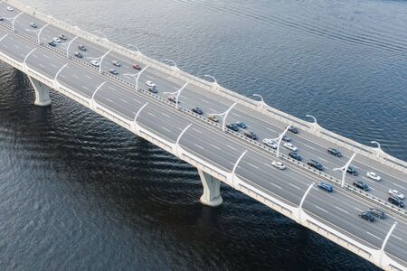 High-speed highway, with multilevel traffic road, the bridge across over the bay sea river. Aerial top view 스톡 콘텐츠