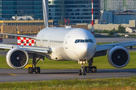 Large passenger aircraft taxiing after landing on runway.