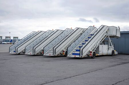 A row of gangways for boarding and alighting passengers from an airplane parked at the airport