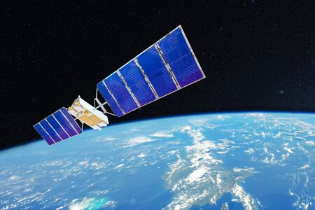 Space satellite orbiting over the ocean earth.