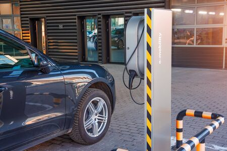Refueling for electric cars e-mobility, the electric plug under voltage restores the battery charge Banco de Imagens