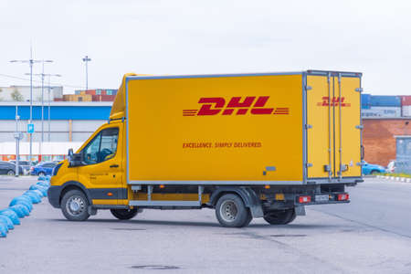 DHL world wide courier company delivery truck on the highway city. Russia, Saint-Petersburg 13 may 2020 Publikacyjne