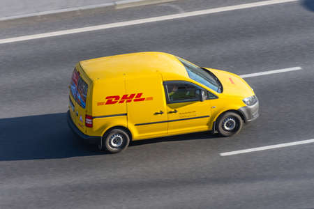DHL world wide courier company delivery small cargo car on the highway city. Russia, Saint-Petersburg 07 may 2020