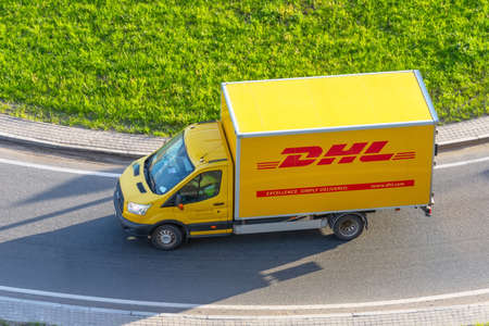 DHL world wide courier company delivery truck on the highway city. Russia, Saint-Petersburg 08 may 2020
