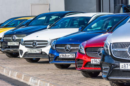 Mercedes-Benz different class and color in a row in front of a dealership. Russia, Saint-Petersburg. 14 may 202