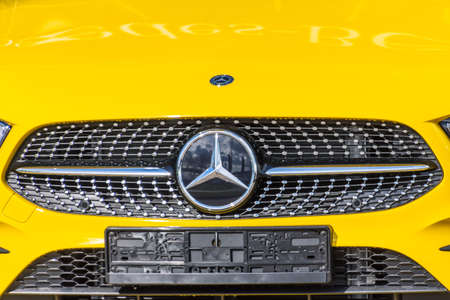 Mercedes Benz yellow close-up of car with logo. Russia, Saint-Petersburg. 14 may 2020