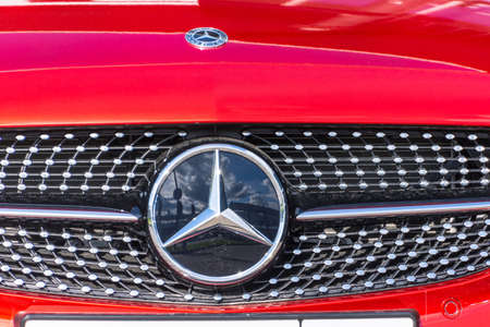 Mercedes Benz red close-up of car with logo. Russia, Saint-Petersburg. 14 may 2020